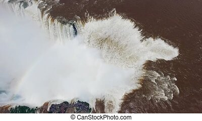 The river falls from a large waterfall. Shevelev. - The...