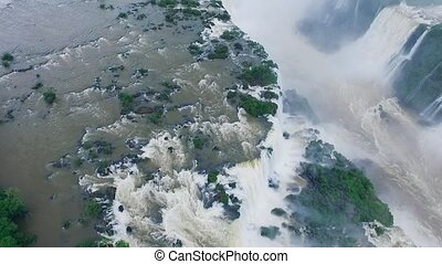 View of the river and the Iguazu Falls surrounded by...
