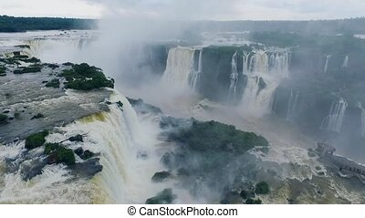 Landscape of large streams of falling water at the Iguazu...