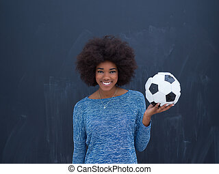 black woman holding a soccer bal - portrait of a beautiful...