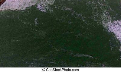 Aerial shot of waves in the Atlantic Ocean on the beach in Swakopmund.