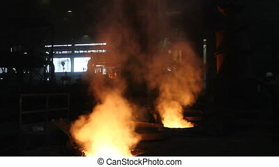 Filling blast furnace with old metal for recycling - Melting...