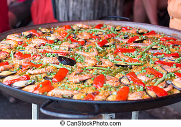 Traditional spanish rice paella with sea food. Mixed seafood...