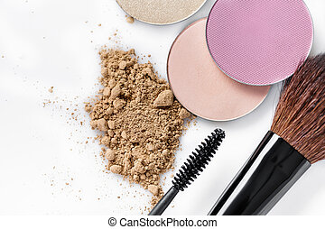 Mascara, beige powder for face, eye shadow and makeup brush...
