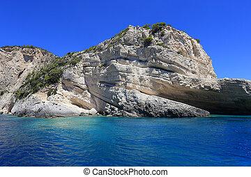 Keri caves on Zakynthos island. Blue sea and rocks on sunny...