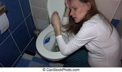 vomiting woman in bathroom in morning. Sad female sickness...