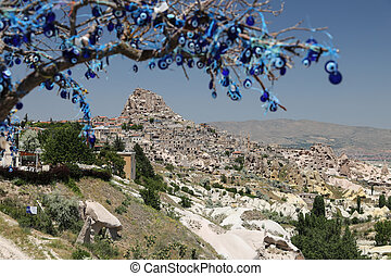 Uchisar Castle and Evil Eye Beads Tree in Cappadocia, Turkey