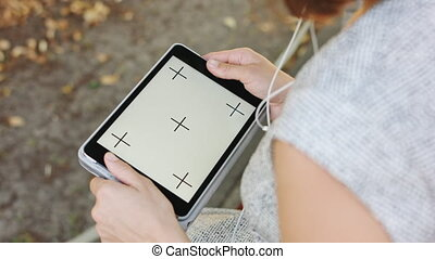 Woman in Park with tablet