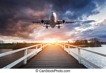 Airplane and wooden bridge. Landscape with passenger...