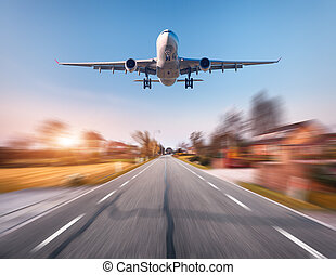 Passenger airplane with motion blur effect. Airplane is...