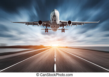 Airplane and road with motion blur effect at sunset....