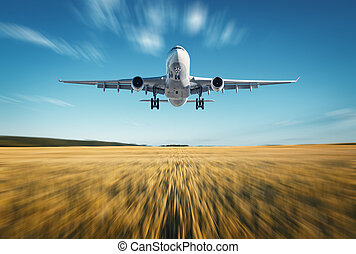 Airplane with motion blur effect. Landscape with white...