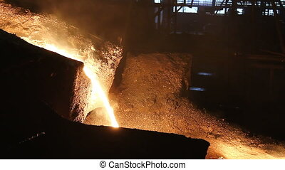 Molten steel pouring - Detail in foundry, molten metal is...