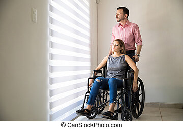 Depressed woman on a wheelchair