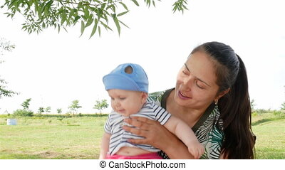 young mother with girl playing outdoors - Beautiful young...