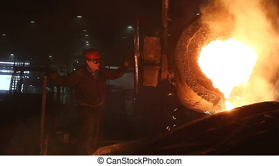 Discharge molten steel pouring from ladle - Worker is...