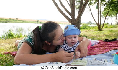 young mother with girl playing outdoors