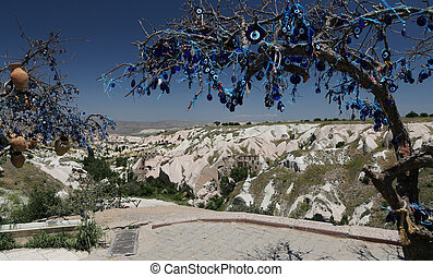 Pigeons Valley and Evil Eye Beads Tree in Cappadocia, Turkey