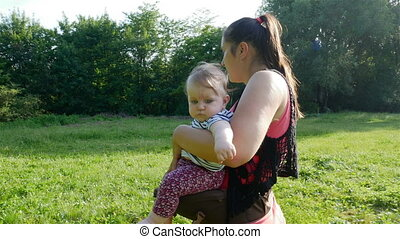 mother walks with newborn - Beautiful young mother walks...