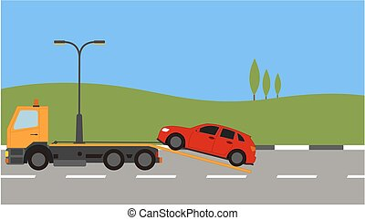Tow truck picking up a car in town