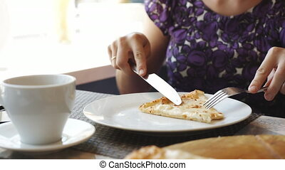 Woman eats pizza in cafe. - Anonymous woman eats pizza in...