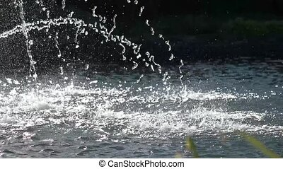 Water streams in slow-mo. Sparkling water surface.