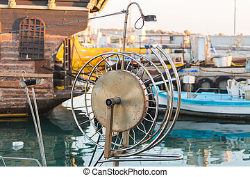 Reel for Retractable Fishing Netting on a Boat.