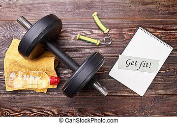 Dumbbell, expander, message, bottle. Get fit in sport gym.