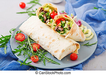 Shawarma from juicy beef, lettuce, tomatoes, cucumbers,...
