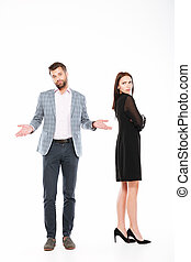 Offence young loving couple standing isolated - Image of...