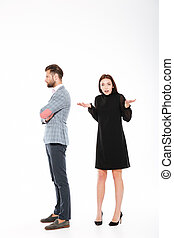 Offence young loving couple standing isolated - Photo of...
