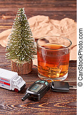 Whiskey, car key, ambulance emergency, paper.