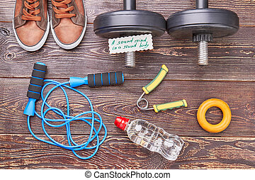 Gym equipment background. Expanders, jumping rope,...