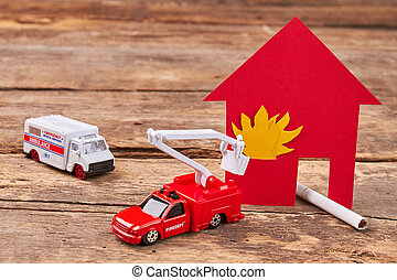 Toy ambulance, fire truck, flame.
