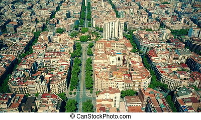 Aerial view of drone flying above famous Barcelona blocks...