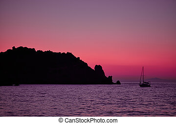 Giglio Island Sea At Dusk - Purple light at dusk over the...
