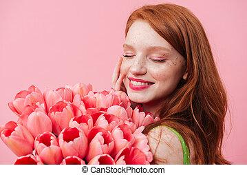 Close up portrait woman holding bouquet of flowers - Close...