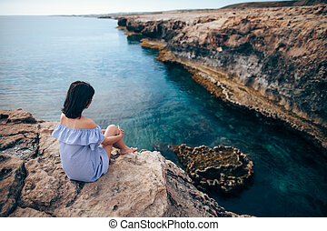 Young woman enjoying beautiful sea view on Greco cape in...