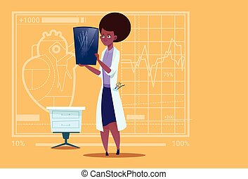 Female African American Doctor Examining Xray Medical...
