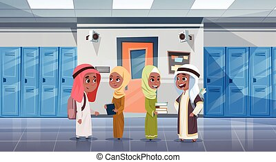 Group Of Arab Pupils Walking In School Corridor To Class...
