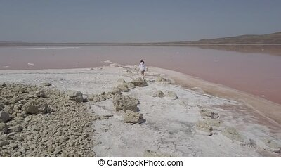 Aerial view of salt lake water evaporation ponds with pink...