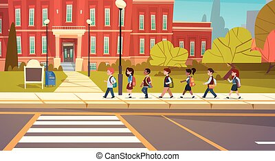 Group Of Pupils Mix Race Walking To School Building Primary...