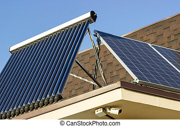 Domestic solar panel on a roof, with clear, cloudless sky