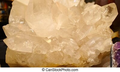 Large crystals of white quartz on dark background