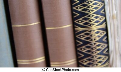 Vintage books. View of row of old books. Low DOF. Closeup.
