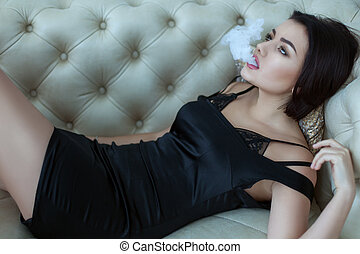 Woman releases smoke from her mouth. - Woman releases smoke...