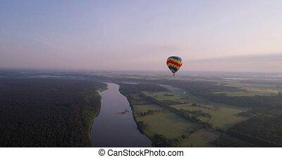 air baloon over green lands at early mornig - air baloon...
