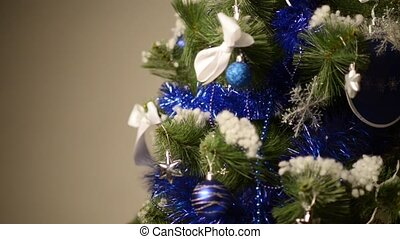 Studio shot of a Christmas tree with colorful ornaments,...