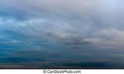 Time lapse clouds on sunset sky - Beautiful fluffy clouds in...