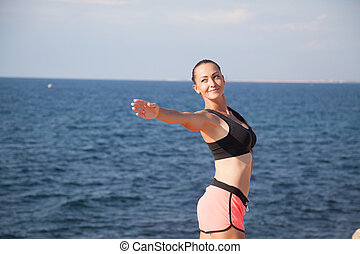 girl Sports Fitness on the beach by the sea 1